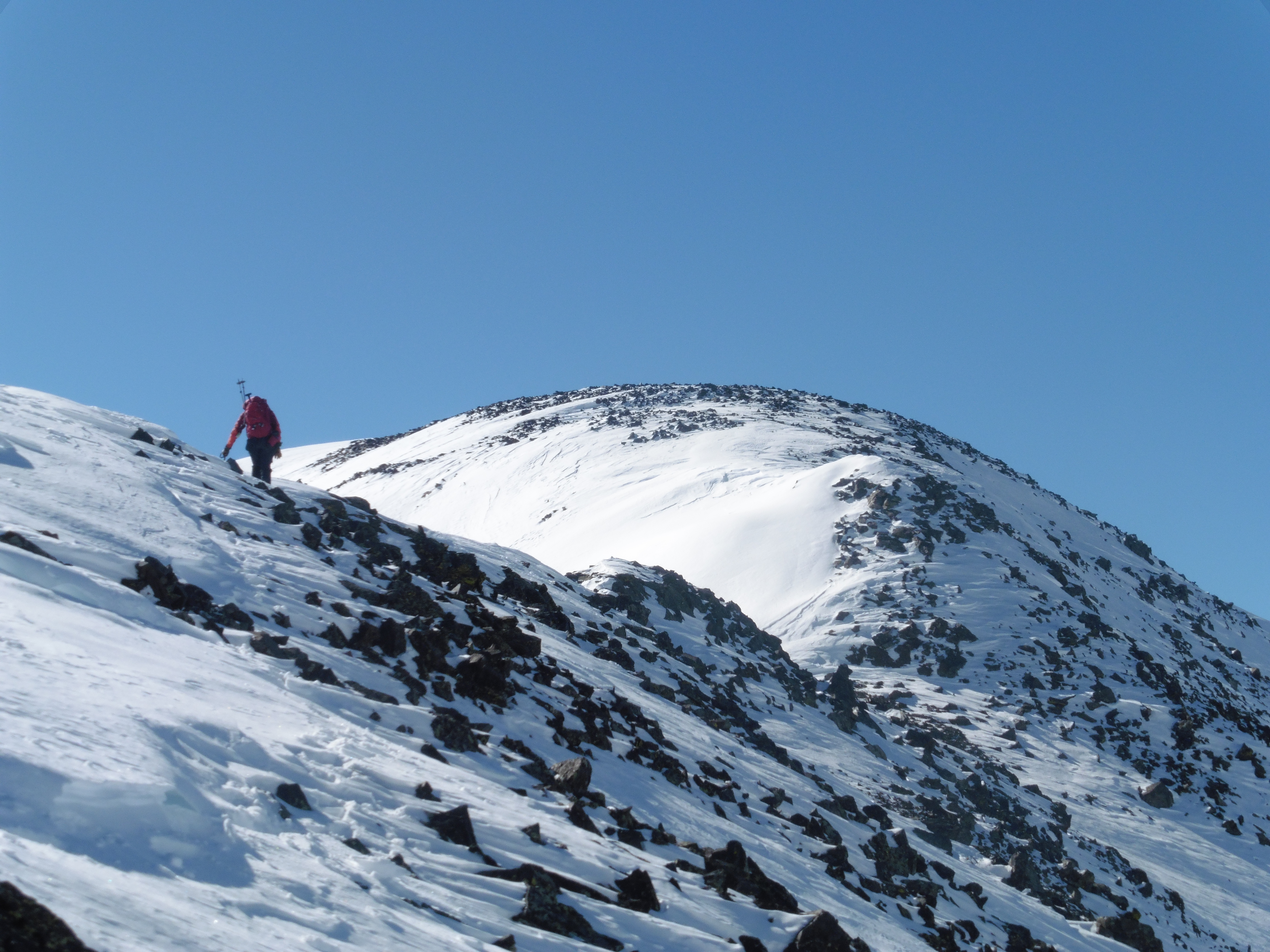 Colin gaining the summit ridge on 12,780B. The corniced knife edge is just beyond the bump that's seen.