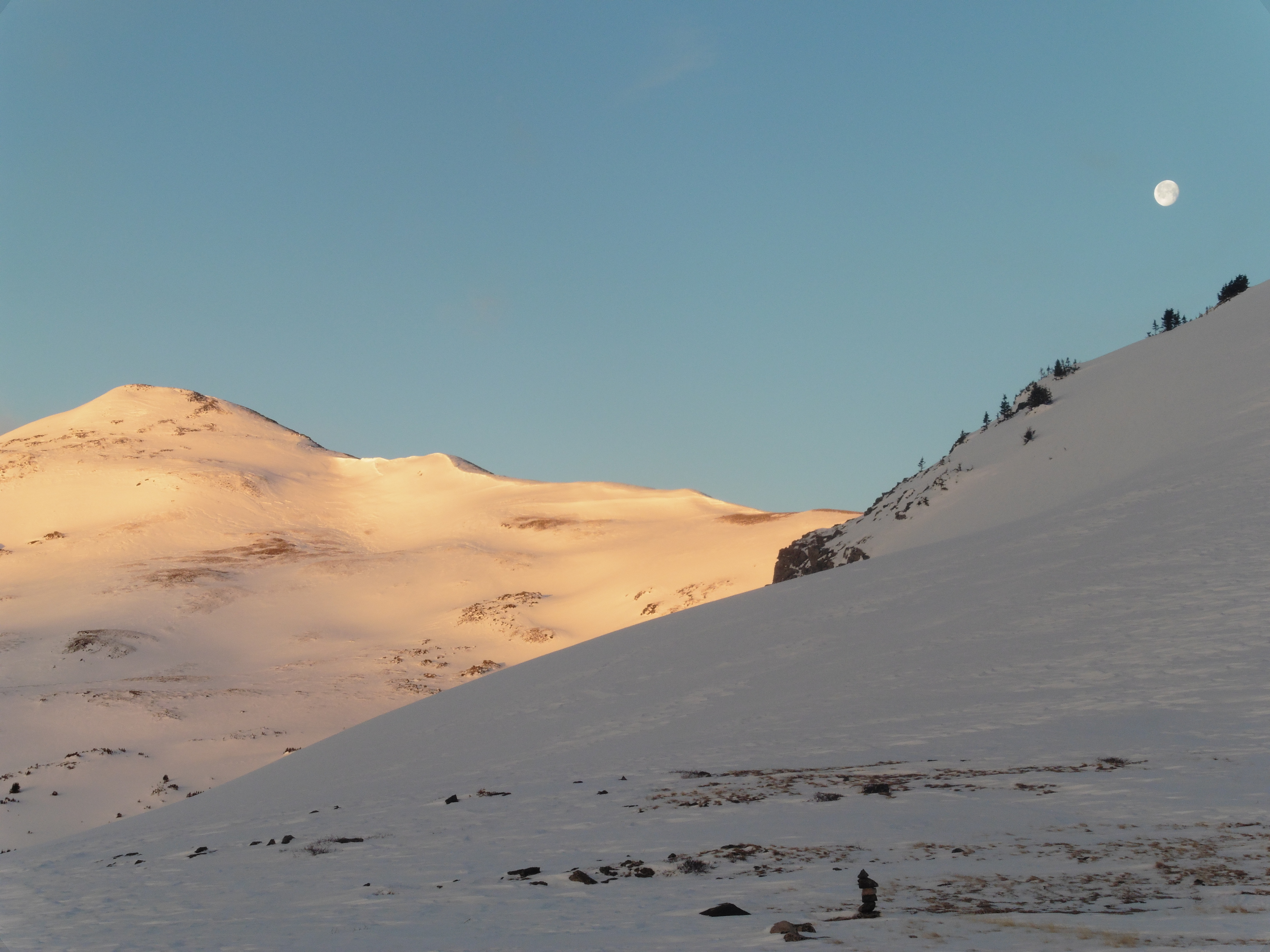 Moon setting over 12,780B in morning alpenglow.